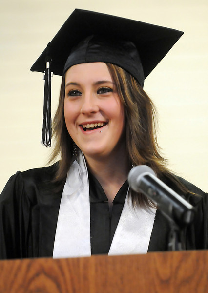 Ferguson High School student Tasha Sweetin speaks to attendees of the school's third quarter graduation ceremony Friday as she prepares to graduate along with six other classmates.
