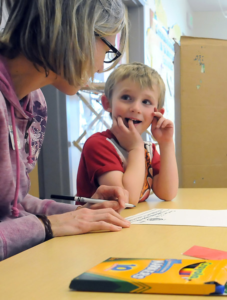 Karin Miller assists preschooler Jacob Wilson, 5, with an exercise on identifying different types of feelings on Tuesday afternoon at Coyote Ridge Elementary School.