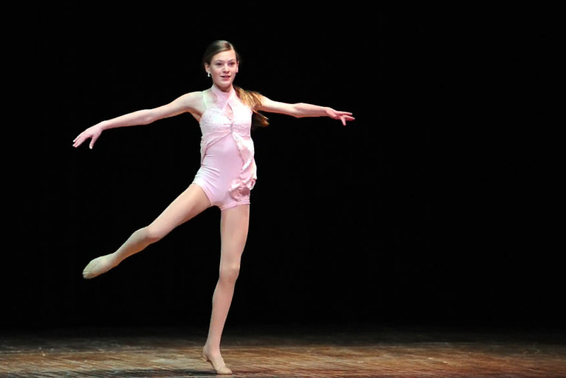 "Morgan Alloway, 12, performs lyrical dance to the song ""Don't Catch Me"" by Kadie Hodges during rehearsals for the Stars of Tomorrow Show on March 24, 2012 at Thompson Valley High School's Roberta Price Auditorium."