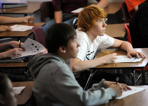 Bill Reed Middle School eighth-graders Cooper Powers, 14, left, and Ethan Marolf, 13, right, look up at their teacher Monday during a lesson in science class at the school in Loveland. Photo by Jenny Sparks