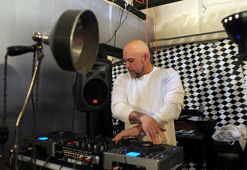 Roland Demers, co-owner of the new Suede event center in south Loveland, demonstrates on the DJ equipment Feb. 27, 2012. (Photo by Craig Young)