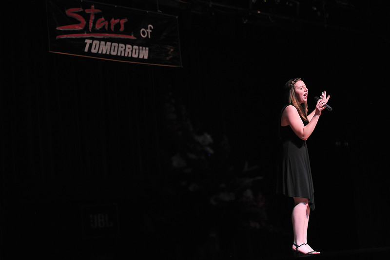 "Brooklyn Buhre, 14, of Johnstown sings ""Don't Rain on My Parade"" by Barbara Streisand during rehearsals for the Stars of Tomorrow on Saturday afternoon at Thompson Valley High School's Roberta Price Auditorium."