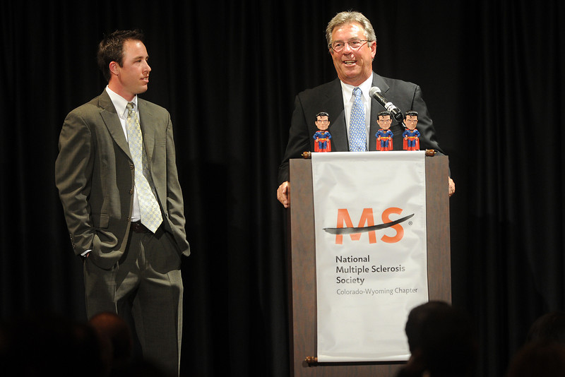 Dave Nichols, right, and his son Steve Nichols stand together onstage after being honored with the 2012 Hope Award by the Colorado-Wyoming Chapter of the National Multiple Sclerosis Society during the 18th annual Northern Colorado Dinner of Champions event Thursday night at the Embassy Suites.