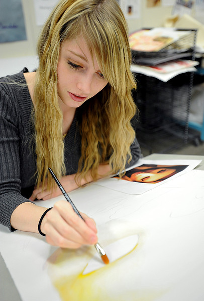 Thompson Valley High School art student Kodi Hays works on a painting during class Wednesday. She recently won a national gold medal for painting and has been invited to the 2012 National Scholastics awards ceremony at Carnegie Hall in New York City on June 1 to receiver her medal. Photo by Jenny Sparks
