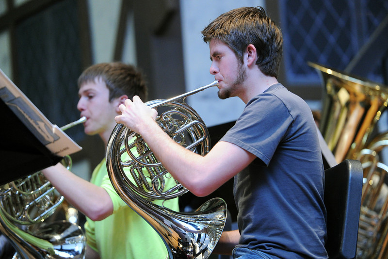 Loveland High School junior Cort Roberts, 17, right, and senior Ian Collett, 17, play French horns during wind symphony class Thursday in the school's auditorium.