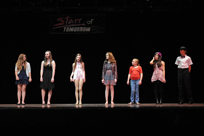 Performers from the middle school division of the Stars of Tomorrow competition stand onstage together as they practice their bows and curtsies during rehearsals on Saturday afternoon at Thompson Valley High School's Roberta Price Auditorium. From left to right are Jessie Madere, 13, Brooklyn Buhre, 14, Morgan Alloway, 12, Kaitlin Wilson, 13, Mikayla Wilson, 12, Daylene Torres, 14, and Christopher Slama, 12.