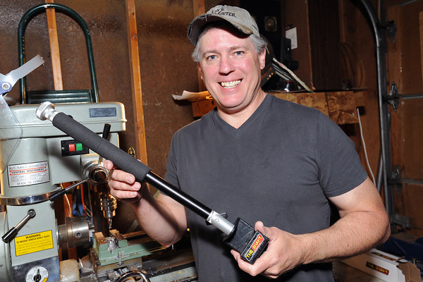 Loveland-based cinematographer Danny Dodge holds a camera stabilizing device he invented called The Shaft on Friday in his workshop. Dodge is starting a fund-raising effort on kickstarter.com to help get the product to market.