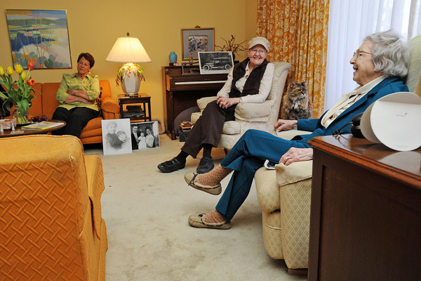 Doris Brown, right, shares a laugh with, back from left, Donna Pelton, cousin Tina Allen and Corry McDowell during a birthday party celebrating Doris' 100th birthday on Tuesday at her Loveland home.