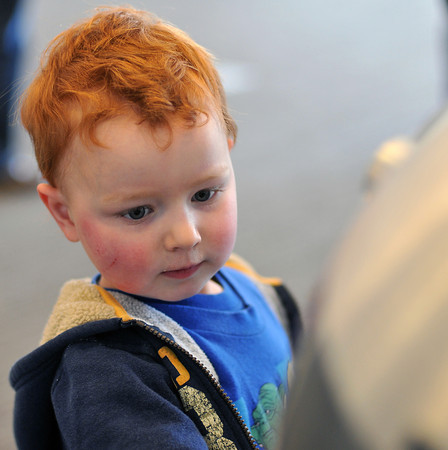 """031812_starwars_MAIN-2-MN.jpg Rylan Abbott, 3, of Loveland examines one of two R2-D2 replicas set up at the Rialto Theater before Sunday's showing of """"Return of the Jedi."""" (Photos by Madeline Novey)"""