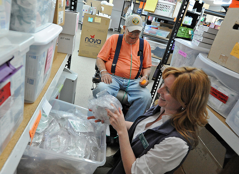 Heather Holmes, director of the Good Healthwill warehouse, helps client Lyle Krings of Loveland find oxygen tubing Friday at the warehouse in Loveland. Photo by Jenny Sparks