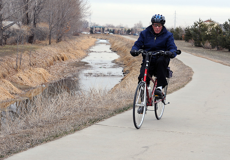 Randall Knapper rides his bike on the Recreation Trail near Boise Avenue in Loveland on Tuesday. The 87 year-old rides his bike about 4,000 miles a year. Photo by Jenny Sparks