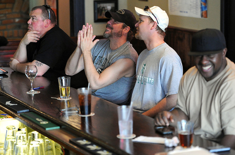 Colorado State University basketball fans hope for a win as they watch the game Thursday at the Sports Station in downtown Loveland. From left they are CSU alumni Chris Marusic, CSU alumni and college roommates Jeff Johnson and Dave Brunning, and Scotty Faggans. Photo by Jenny Sparks