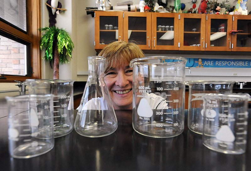 Science teacher Jacque Rideout poses for a photo Monday with beakers and a volumetric flask in her classroom. Photo by Jenny Sparks