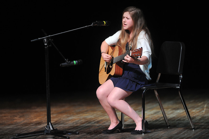"Jessie Madere, 13, plays guitar and sings the Green Day song ""Time of Your Life"" during rehearsals for the Stars of Tomorrow on Saturday afternoon at Thompson Valley High School's Roberta Price Auditorium."