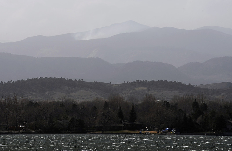 Wind creates choppy waves on Lake Loveland as plumes of smoke from a wildfire west of town are seen Monday afternoon. Photo by Jenny Sparks