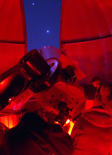 Students from Loveland High School look at Jupiter, above, after they had viewed Venus on Wednesday at the Little Thompson Observatory. Photo by Jeff Stahla