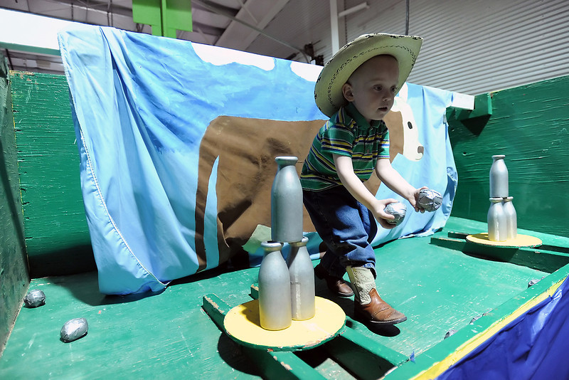 Daiton Crego, 5, helps out at the Buckeye Buccaneers 4-H Club's Bottle Ballistics booth during the 4-H Carnival on Saturday, March 17, 2012 at The Ranch.