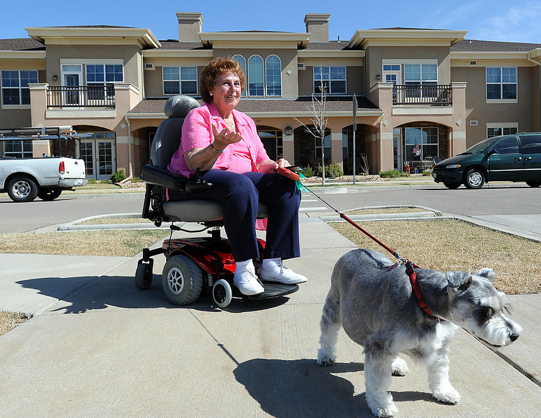 On a break from taking a stroll with her dog Nikki, a 6 year-old schnauzer, Barb Reines talks about how much she enjoys living at the Mirasol Senior Living Commuity. She was the first resident to move into the complex in July 2007. Photo by Jenny Sparks