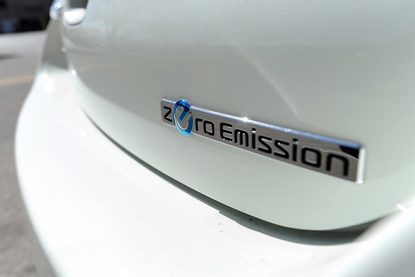 A badge on the back of a 2012 Nissan Leaf SV parked in downtown Loveland on Wednesday afternoon during the Green Car Convoy identifies it as a zero emission all-electric vehicle.