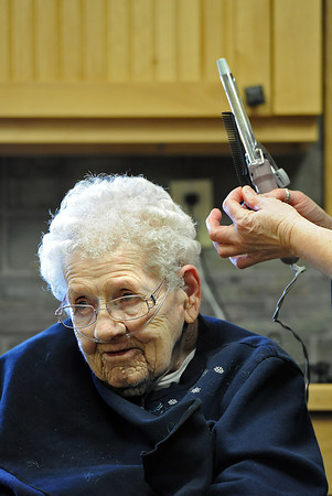 Josephine Fossett gets her hair done by cosmetologist Julie Acres Wednesday afternoon at the Good Samaritan Village in Loveland before a special dinner and receiving a 50-year service pin from the women's auxiliary of VFW Loveland Post 41. Photo by Jenny Sparks
