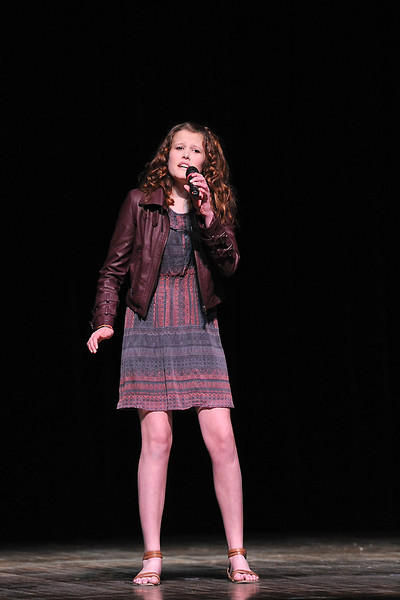 "Kaitlin Wilson, 13, sings the Christina Perry song ""Arms"" during rehearsals for the Stars of Tomorrow on Saturday afternoon at Thompson Valley High School's Roberta Price Auditorium."