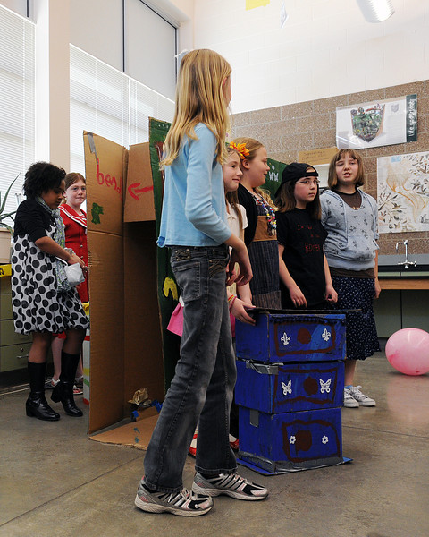 "Coyote Ridge Elementary School students perform their long-term component called ""To Be Or Not To Be"" during the Longs Peak Regional Tournament of Odyssey of the Mind on Saturday at Berthoud High School. From left are Olivia Johnson, 8, Katja Searle, 9, Katrina Nelson, 9, Natalie AmRhein, 8, Tehya Searle, 8, Lindsey Brayer, 10, and Haley Pritchard, 10."