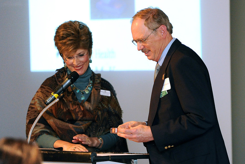 McKee Medical Center Foundation executive director Julie Johnson Haffner, left, presents Wayne Williamson with the McKee Community Health Award during the McKee Thanks luncheon on Thursday, March 8, 2012. Williamson is a physician's assistant and site medical director at the Loveland Community Health Center.