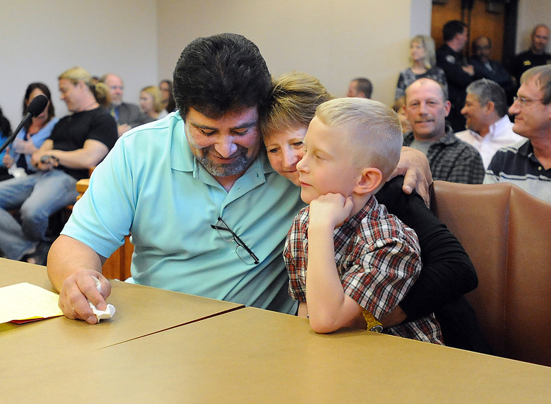 Danny Ortiz, left, and Laura Scheib, the first graduates of the Larimer County DUI court, congratulate each other Friday at the Larimer County Justice Center in Fort Collins. Lucas Scheib, 7, sits on his mother's lap. The court, which started in July 2010, is designed to rehabilitate high-risk, high-need repeat DUI offenders. No participants have dropped out or been discharged due to noncompliance since the court started. Photo by Jenny Sparks