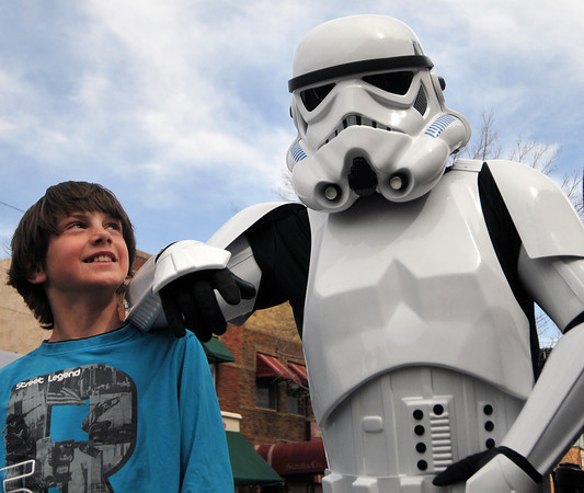 031812_starwars_4-MN.jpg Noah Kline, 13, stands Sunday outside Loveland's Rialto Theater with Rob Webb of Brighton, a Star Wars stormtrooper . Webb is among dozens of members of the 501st Legion, a group of people from Colorado and surrounding states that don Star Wars costumes and make appearances at benefits and other events. (Photo by Madeline Novey)