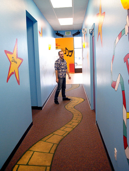 Brandon Harrington, owner of the Harrington Arts Academy, shows off one of the areas at the event center in Loveland.