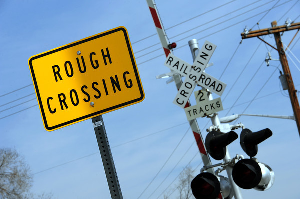 A sign warns drivers of the tattered railraod crossing located in Loveland on 10th Street between Cleveland and Garfield Avenues on Thursday, March 8, 2013. Railraod crews plan to repair this, along with three others in May.