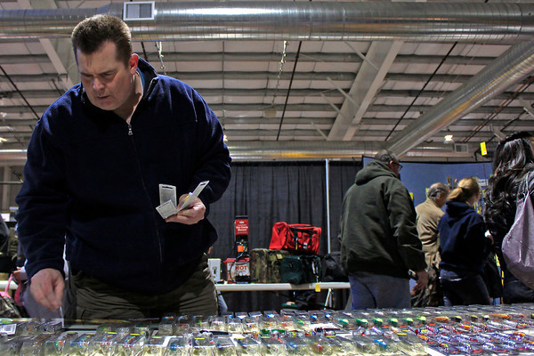 Bass fisherman Scott Adams browses a selection of lures Sunday afternoon at the Matzuo display during the Ninth Annual Larimer County Fishing Expo at the First National Bank Exhibition Hall in Loveland, Colo.