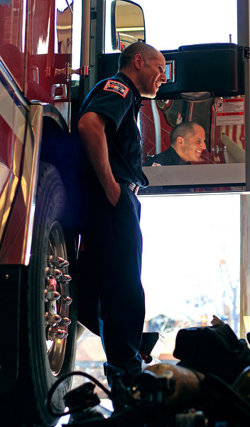 Loveland Fire Rescue Authority Lt. Rene Marcias leans against one of Fire Station 2's trucks as he explains his plans to participate next Sunday in the 2013 Scott Firefighter Stair Climb which raises money for the Leukemia and Lymphoma Society.