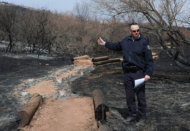 Larry Butterfield, Lory State Park Manager, talks Friday about one of the many bridges that burned in the Galena fire at Lory State Park west of Fort Collins. Bridges were the only structures that were destroyed by the fire.