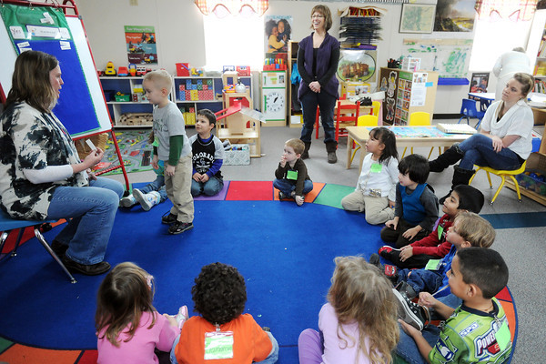 Preschool teacher Patti Babiuch, left, asks Ty Brown, 4, if he likes to sing during a learning activity on Tuesday, March 12, 2013 at the Thompson Integrated Early Childhood Program. The school includes students from Head Start, tuition based, special need and the Colorado Preschool Program.