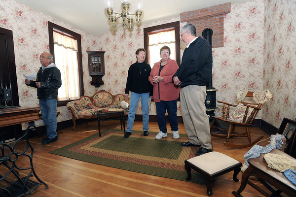 Mike Perry, left, Ann Ague, Sharon Perry and Lou Price stand together March 1, 2013 in the Milner-Schwarz house in Loveland while talking about the upcoming Historic Homes Tour.