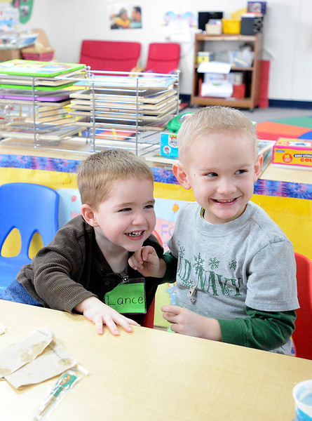 Lance Foster Riggert, 4, left, is full of giggles and smiles during snacktime with his friend Ty Brown, 4, right, at the Thompson Integrated Early Childhood Program on Tuesday, March 12, 2013.