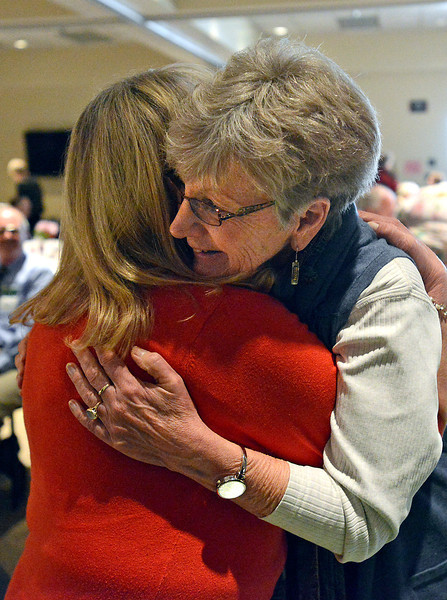 Nancy Jakobsson, right, gets a hug from Lin Boysen after Jakobsson received the McKee Communtiy Health Award during a luncheon at the McKee Conference and Wellness Center in Loveland on Thursday, March 14, 2013.