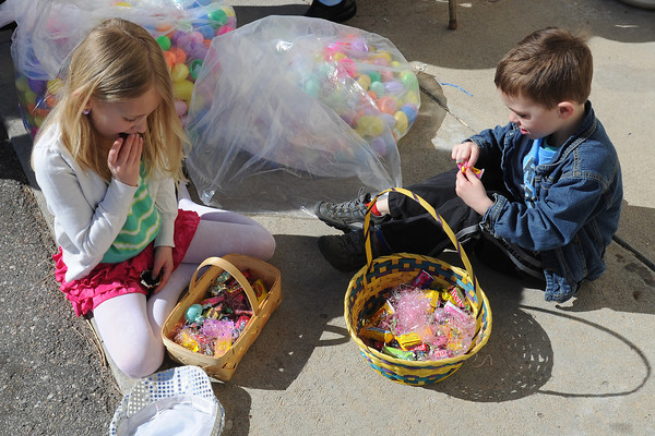Hayley Fowler, left, and her brother Max Fowler, 4, sample some of the treats in their baskets full of goodies after participating in an Easter Egg hunt Saturday, March 30, 2013 at Buckhorn Presbyterian Church.