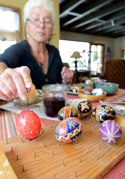 Traudl Renner sets an egg aside to dry while using a Ukrainian technique to decorate Easter eggs at her Loveland home on Wednesday, March 27, 2013.