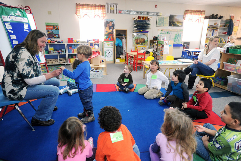 Preschool teacher Patti Babiuch, left, asks Dakota Garcia, 3, if he likes to sing during a learning activity on Tuesday, March 12, 2013 at the Thompson Integrated Early Childhood Program. The school includes students from Head Start, tuition based, special need and the Colorado Preschool Program.
