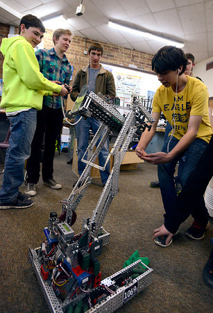 One of Berthoud High School's robotics teams prepares for the upcoming VEX World Championships in Anaheim, CA, on April 17-20. From left to right, Brandon Montero, 18, Mitch Sandell, 16, Tevor Von Seggern, 17, and Bryan Montero, 16, demonstrate the capabilities of their robot.