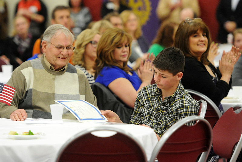 Robert Redder, left, and his great-grandson Jaiden Perry, 12, look at the certificate Redder was awarded during the 2013 Heroes Among Us event on Thursday, March 21, 2013 at Immanuel Lutheran Church. Jaiden nominated his great grandfather for the honor and wrote that he is involved in many areas of his life including helping with school work and attending Jaiden's sports events.