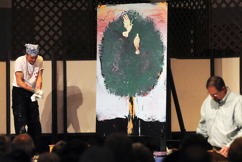 Loveland-based artist Scott Freeman, left, stands next to the performance art piece he completed during a Maundy Thursday <br /> Worship on Thursday, March 28, 2013 at Mountain View Presbyterian Church.
