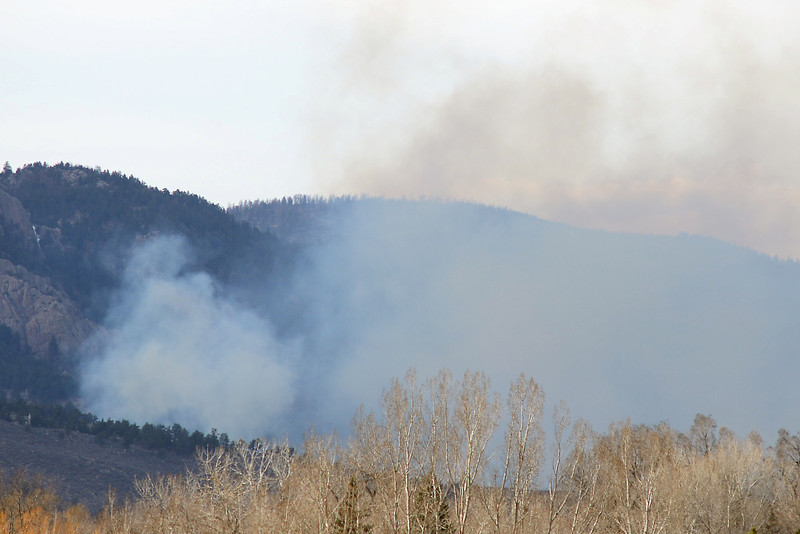 Smoke rises from the Galena fire on Friday, March 15, 2013 to the west of Horsetooth Reservoir.