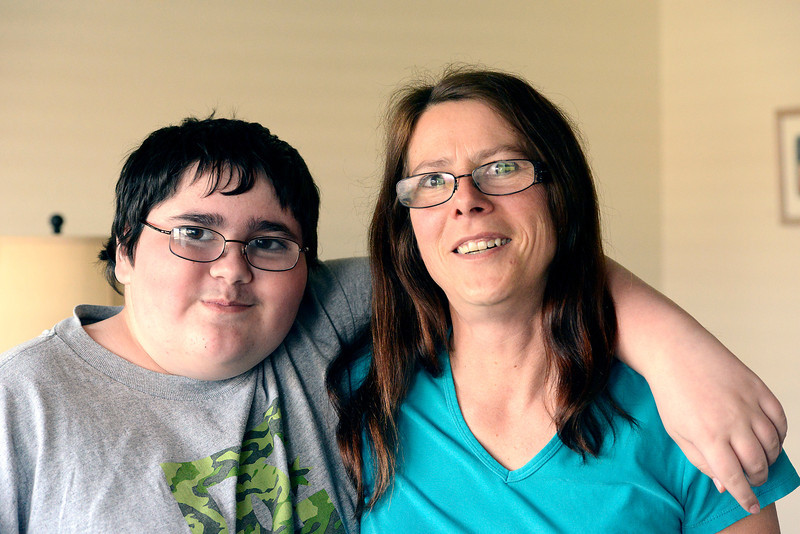 Alex Bray, 12, and his mother Linda Bray, smile for the camera in their Berthoud home on Wednesday, March 13, 2013. Alex was diagnosed with brain cancer at age 7 and there will be a fundraiser to support the family at the Berthoud Community Center on March 24.