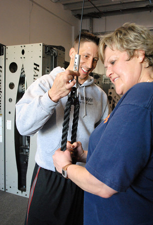 """Ryan """"Cowboy"""" Ehmann, also known as the """"Lose 12 Inches Guy"""", instructs a client during one of his workout sessions in Loveland on Wednesday, March 6, 2013. Ehmann will appear in the show """"Shark Tank"""" which airs this Friday."""