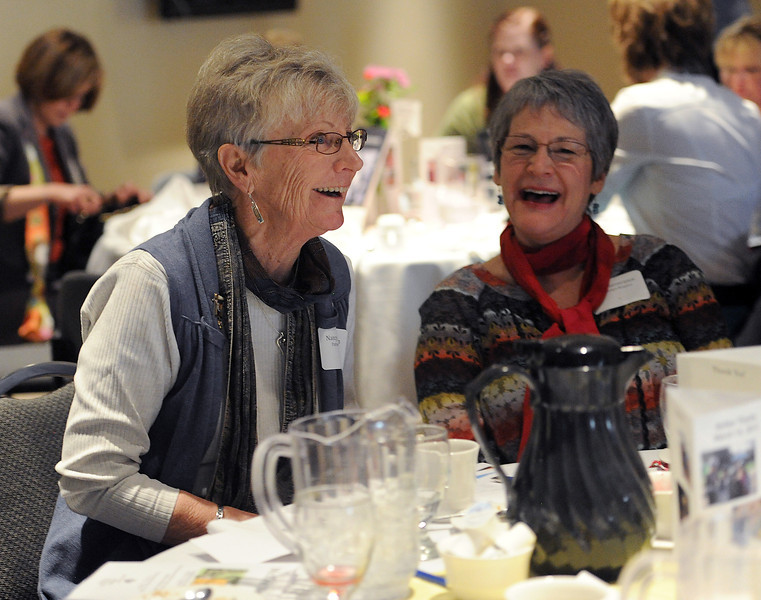 Nancy Jakobsson, left, and long time co-worker Janet Severance, right, smile after Jakobsson received the McKee Communtiy Health Award during a luncheon at the McKee Conference and Wellness Center in Loveland on Thursday, March 14, 2013.