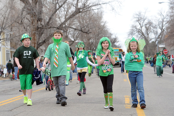 Jacob VanDress, 12, left, Austin Lousberg, 10, Hailey Ramos, 9, and Lexi Duran, 8, walk together as part of the Young People's Learning Center entry during the Lucky Joe's St. Patrick's Day Parade on Saturday, March 16, 2013 in Old Town in Fort Collins, Colo.