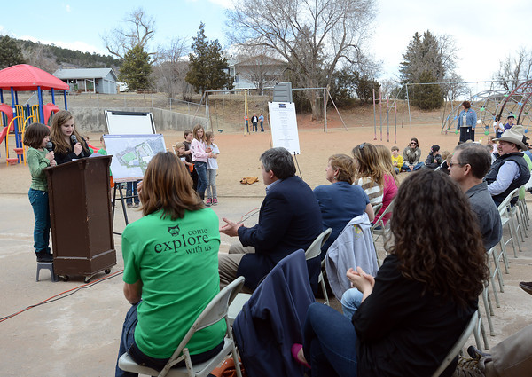 Lydia Fournier, 8, left, and her sister Sierra Fournier, 13, give a speech together during a groundbreaking event March 29, 2013 at Big Thompson Elementary School for the school's new playground that's scheduled to open in August.